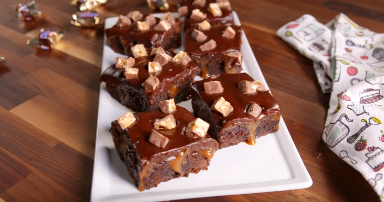 Snickers Poke Brownies