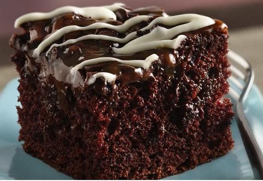 A Wonderful Chocolate Poke Cake With Chocolate Chips & Caramel